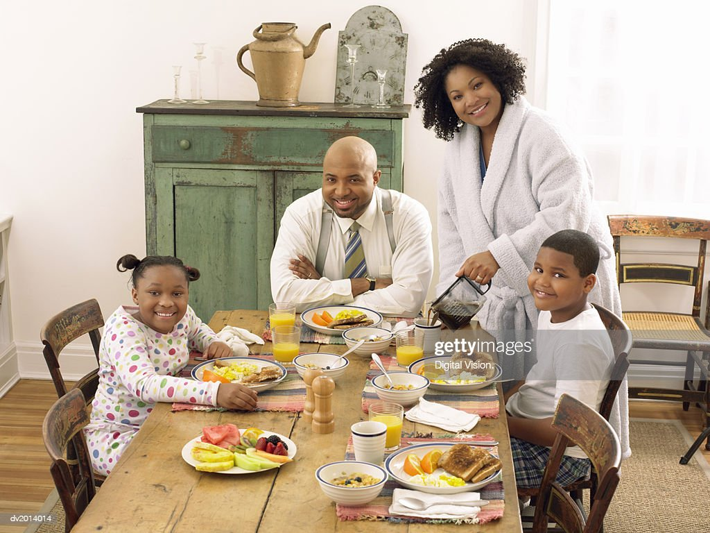 Family Sitting in a Kitchen at Breakfast : Stock Photo