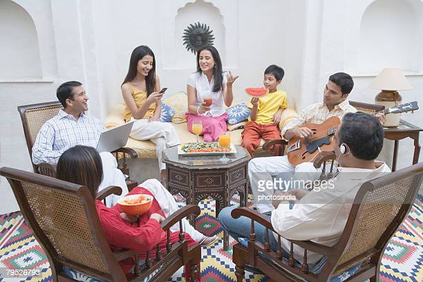 Family sitting in a room and smiling