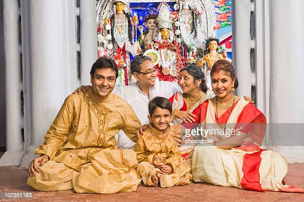 Family sitting in a temple