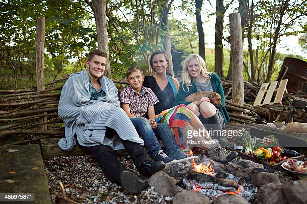 Family sitting in front of bonfire