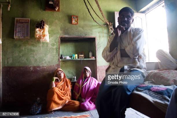 Family sitting in house, Salunkhewadi, Nandur, Marathwada, Maharashtra, India
