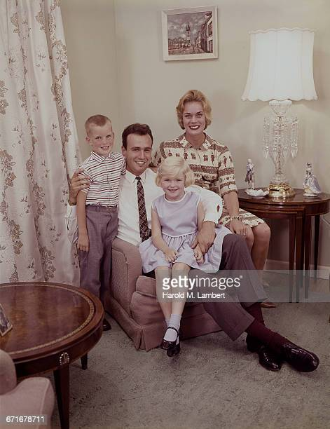 """family sitting in living room, portrait "" - neckwear stock pictures, royalty-free photos & images"