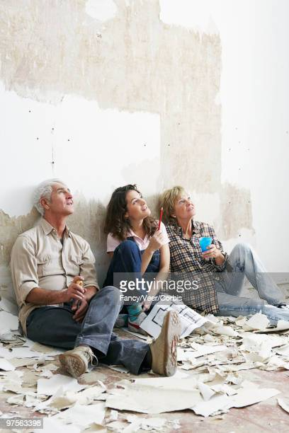 Family sitting in unfinished room