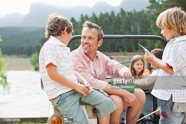 Family sitting in vehicle