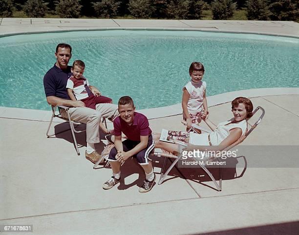 Family Sitting Near Swimming Pool