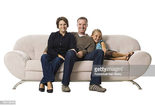 Family sitting on a couch
