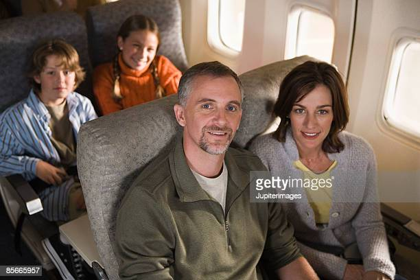 Family sitting on airplane