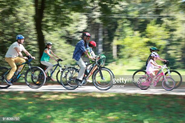 Family sitting on bicycle