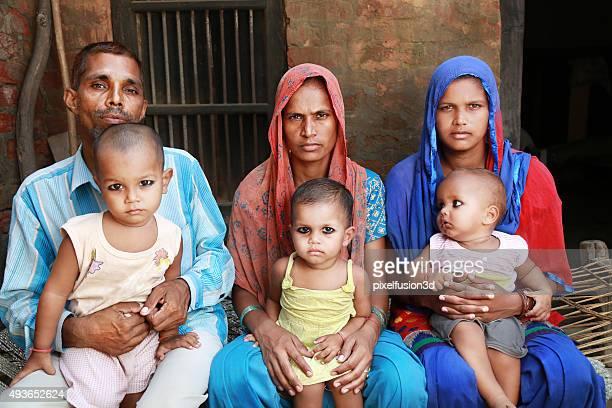 Family Sitting on Charpai Portrait