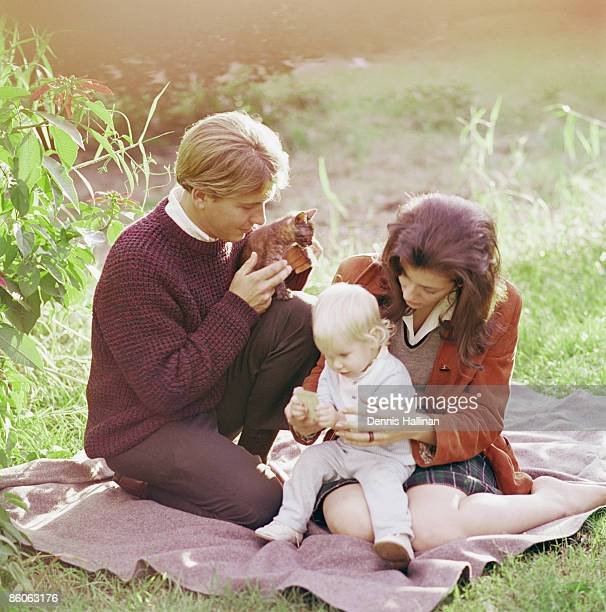 Family sitting on picnic blanket
