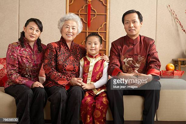 A family sitting on the sofa celebrates Chinese New Year.