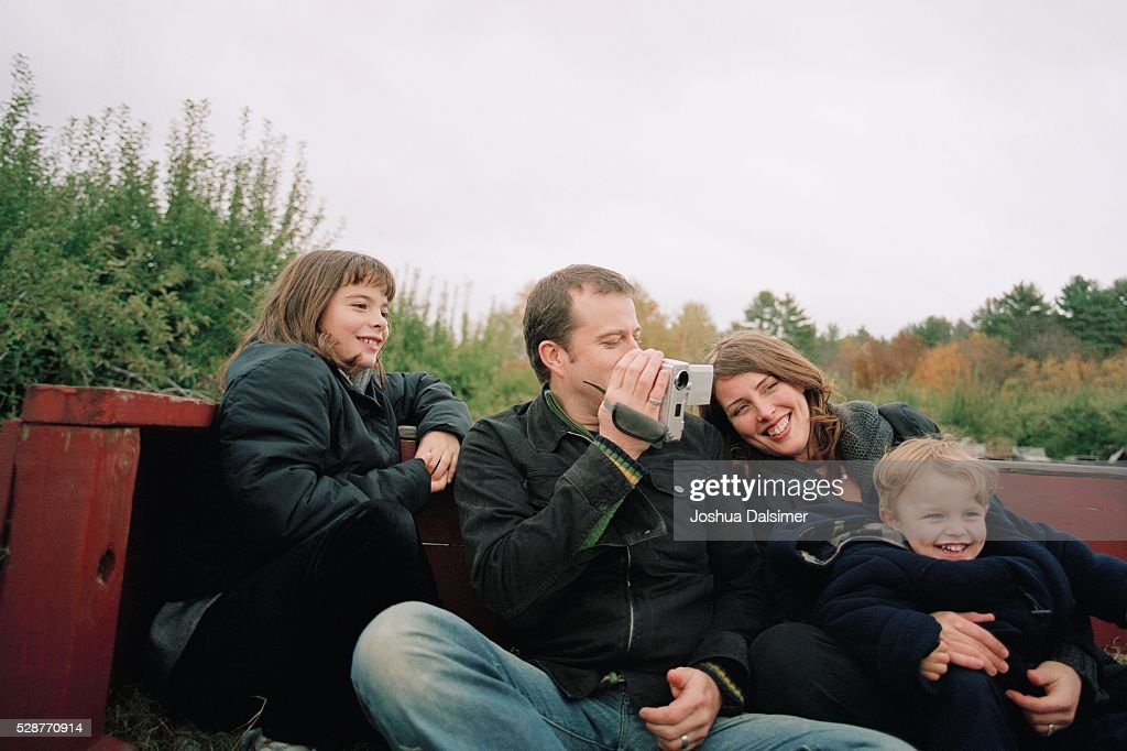 Family sitting side by side : Stock Photo