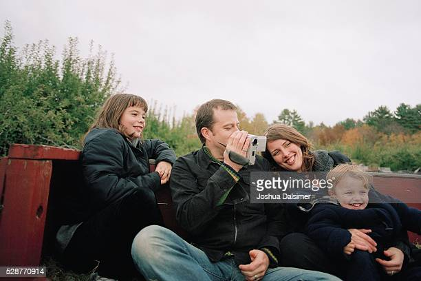 Family sitting side by side