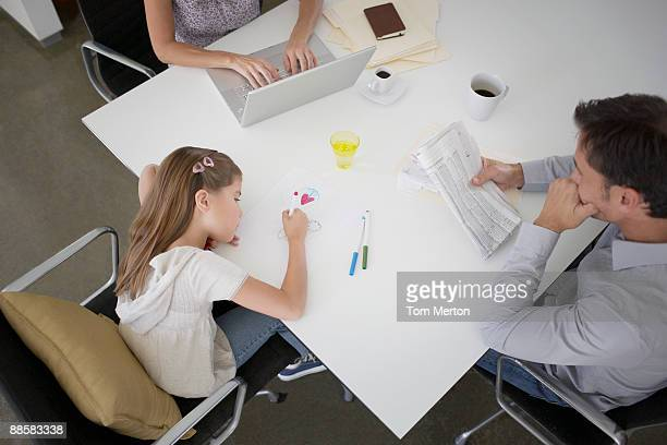 Family sitting together at dining table