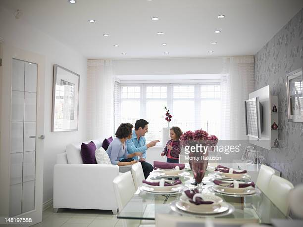 Family sitting together in living room of energy efficient house