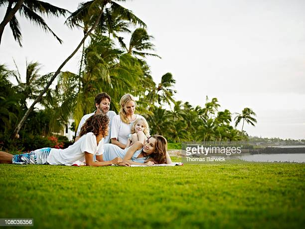 Family sitting together on grass