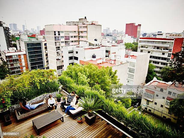 Family sitting together on rooftop patio of home