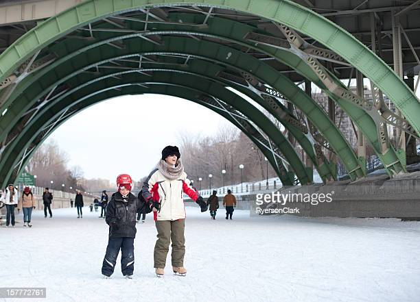 family skating on the rideau canal, ottawa, canada - ottawa stock pictures, royalty-free photos & images