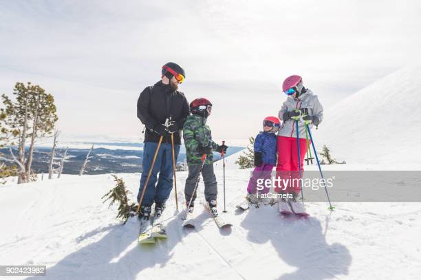 family skiing holiday! - ski holiday stock photos and pictures