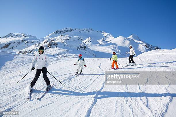 family skiing on sunny day