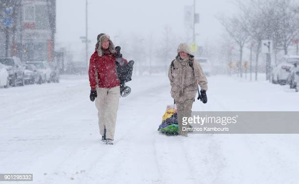 A family sledding in the snow during a massive winter storm on January 4 2018 in New York City From Maine to Florida every state along the east coast...