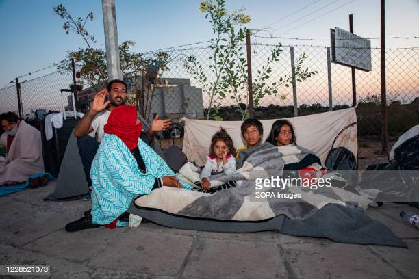 Family sleeps on streets after a devastating fire in Moria camp in Lesbos. More than 13,000 Asylum seekers flee fire at Greece's largest migrant...