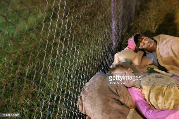 A family sleeps outside in the early morning as they wait to enter a free clinic on July 22 2017 in Wise Virginia Hundreds of Appalachia residents...