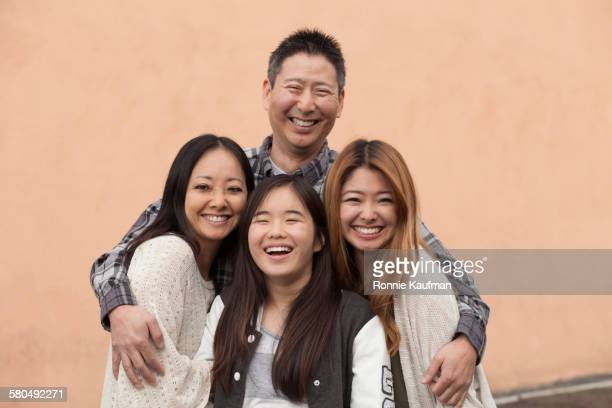 family smiling outdoors - 45 49歳 ストックフォトと画像