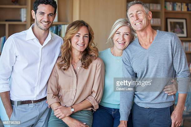 Family smiling together in living room