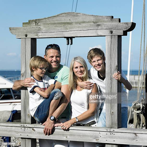 Family smiling together on pier