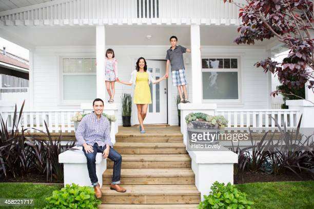 Family smiling together on porch