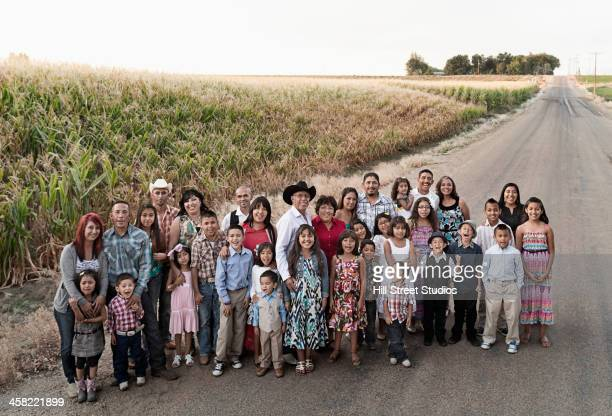 family smiling together on rural road - large family stock pictures, royalty-free photos & images