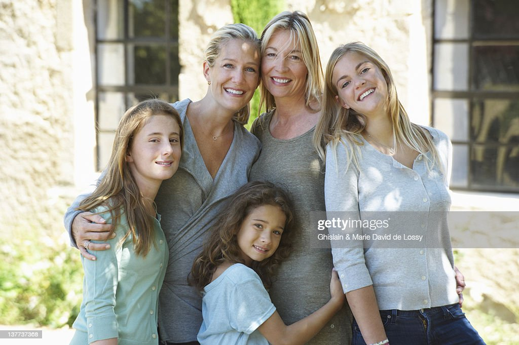 Family smiling together outdoors : Stock Photo