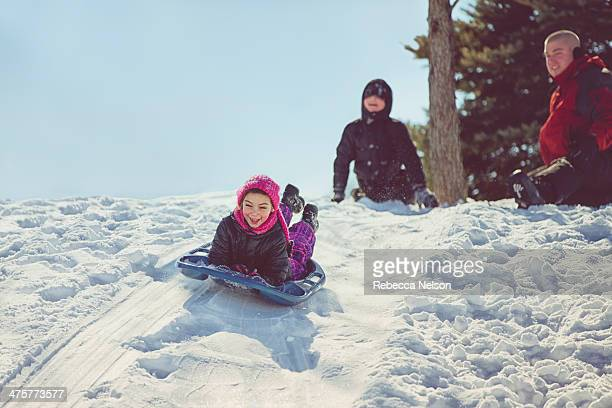 Family Snow Sledding