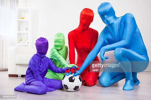 family soccer fans. - bodysuit stock pictures, royalty-free photos & images
