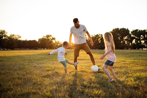 Family soccer game 1022823516