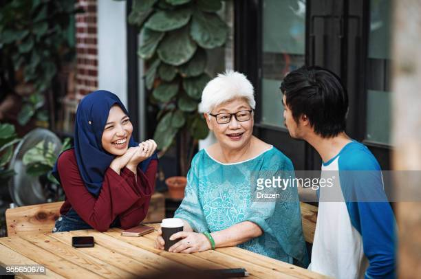 family spending afternoon wth grandmother - disruptaging stock photos and pictures