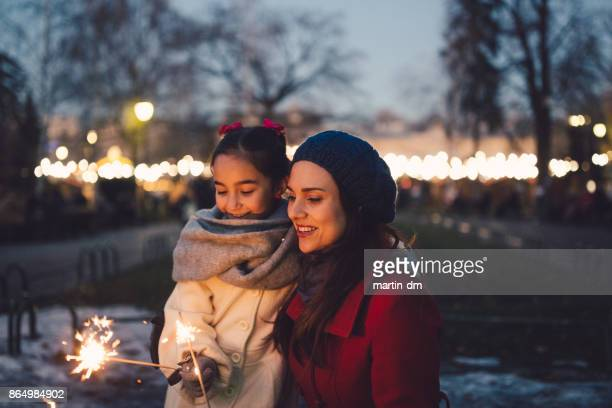 family spending christmas outside - sparkler stock photos and pictures