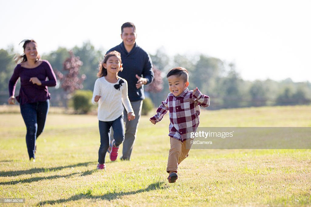 Family Spending Time Outdoors : Stock Photo