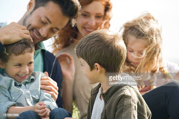 family spending time together outdoors - large family stock pictures, royalty-free photos & images