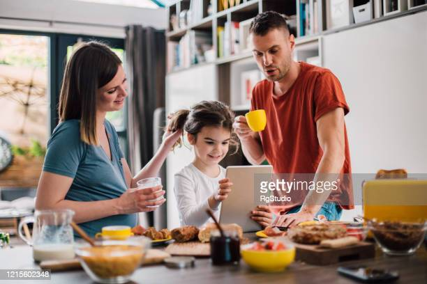 family spending weekend morning together - breakfast cartoon stock pictures, royalty-free photos & images