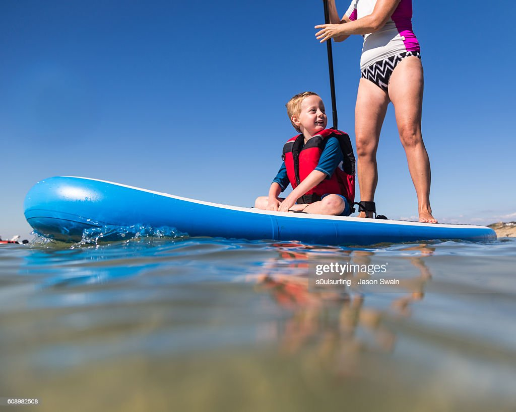 Family Stand Up Paddleboarding on the Isle of Wight. : Stock Photo