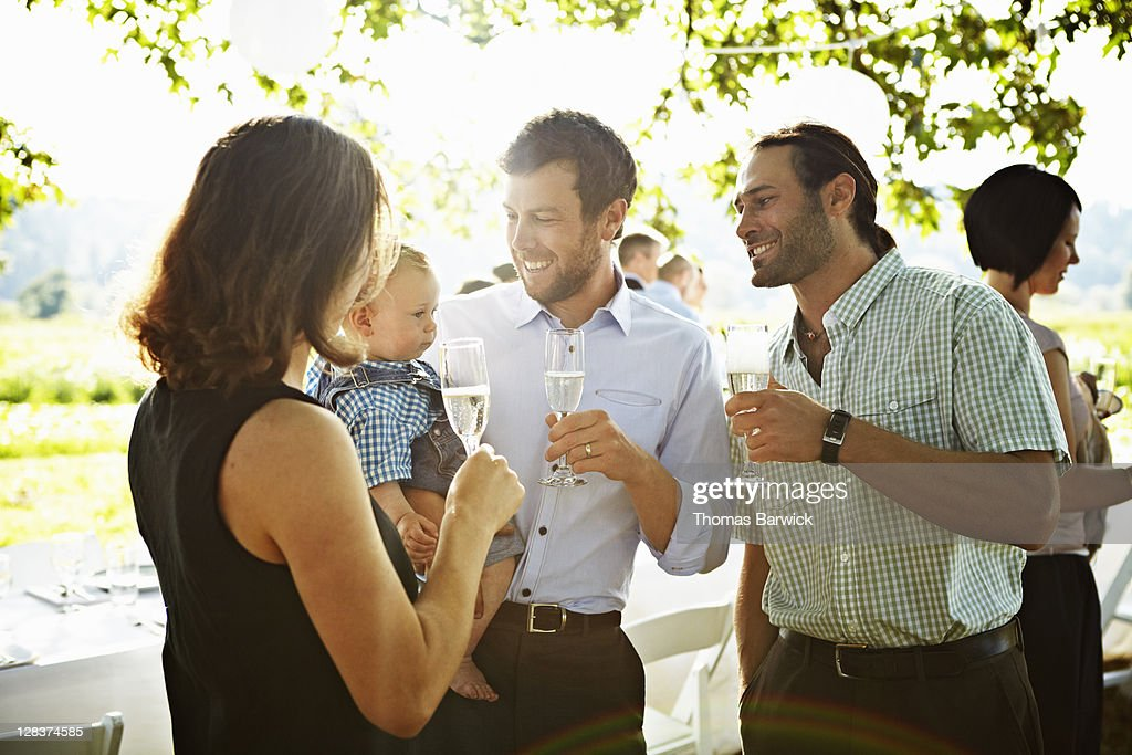 Family standing drinking champagne : Stock Photo