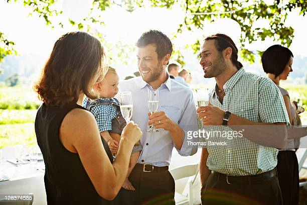 Family standing drinking champagne