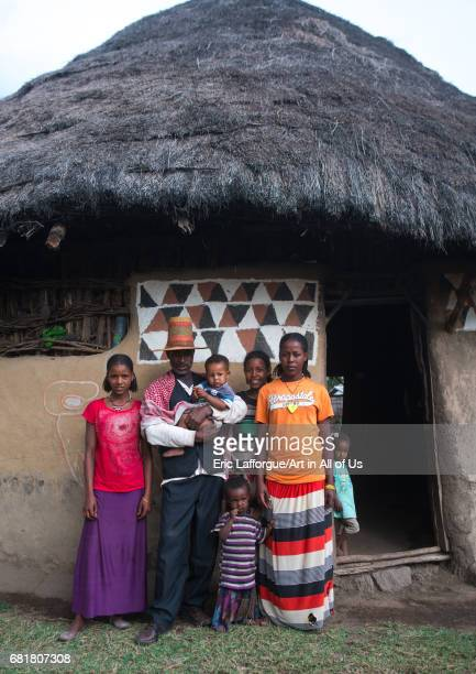 Family standing in front of a traditional painted house Kembata Alaba Kuito Ethiopia on March 9 2016 in Alaba Kuito Ethiopia