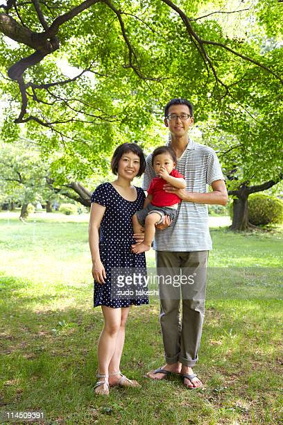 A family standing in the fresh green.