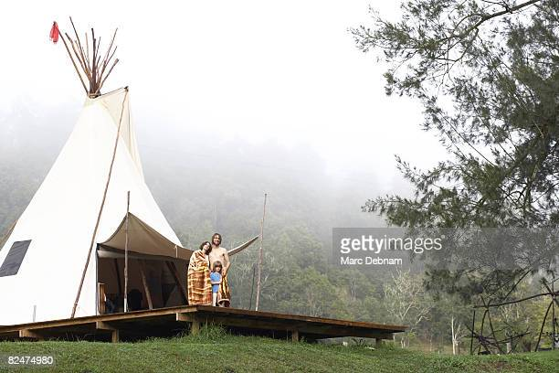 Family standing on deck of teepee