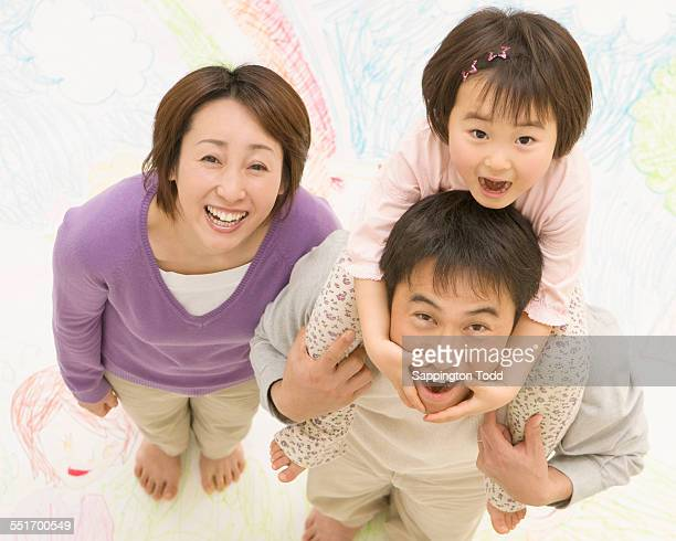 family standing on drawing - tierfigur stock-fotos und bilder