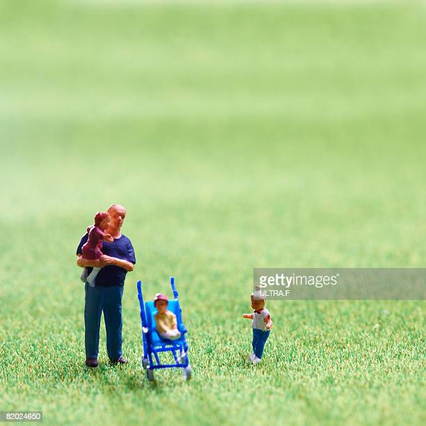 Family standing on the green field