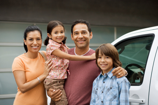 Family standing outside house next to car - gettyimageskorea